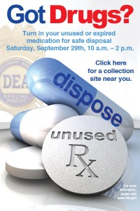 "Several nondescript medications on a poster that reads, ""Got drugs? Turn in your unused or expired medication for safe disposal"""